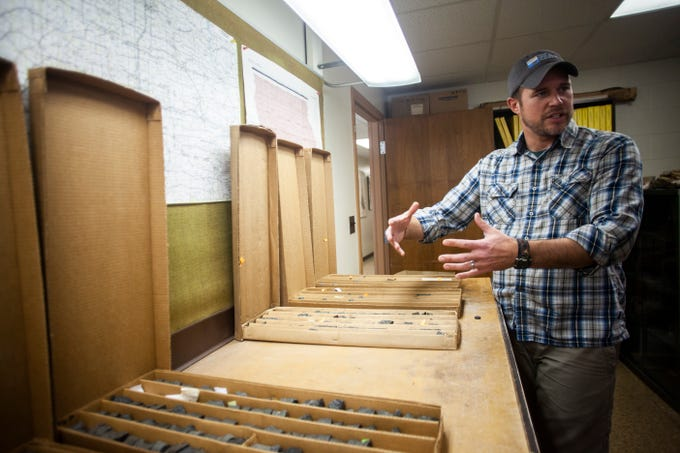 Ryan Clark of the Iowa Geological Survey shows halves of core samples taken in northeast Iowa on Monday, Jan. 7, 2019, at his office in the at UI Oakdale Research Campus in Coralville, Iowa.