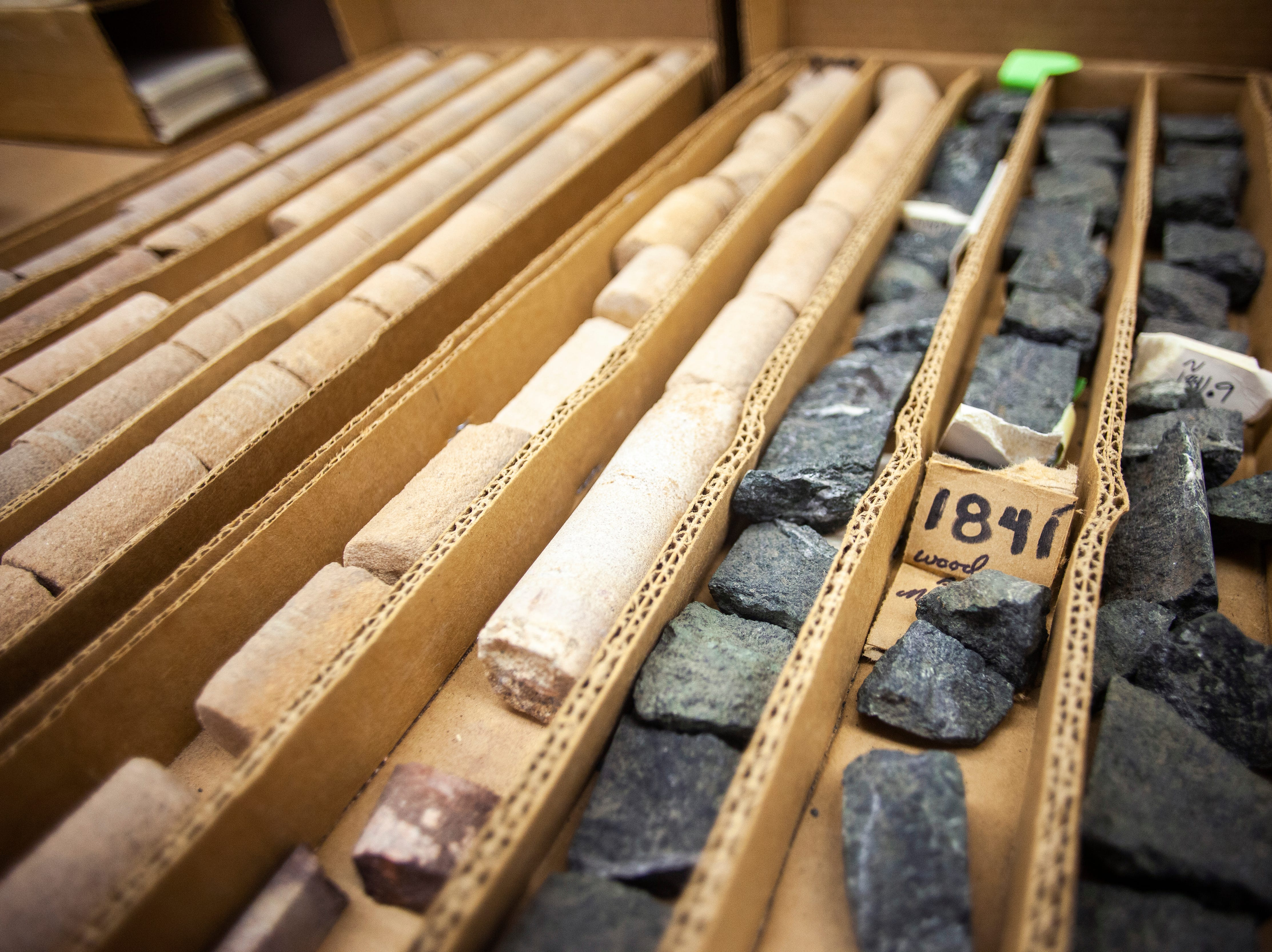 Halves of core samples from taken in northeast Iowa beginning at 1812 feet with sandstone in the upper left and transitioning into a darker, potentially mineral rich rock, on the right, on Monday, Jan. 7, 2019, at his office in the at UI Oakdale Research Campus in Coralville, Iowa.