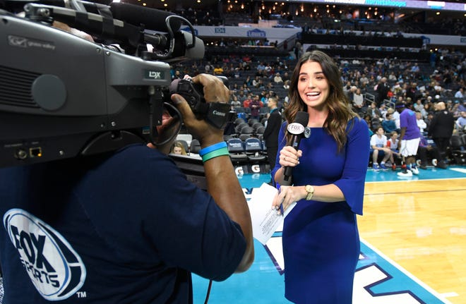 In this Dec. 19, 2018 photo, Ashley ShahAhmadi broadcasts from the baseline during a break in the Charlotte Hornets game against the Cleveland Cavaliers at the Spectrum Center in Charlotte, N.C.