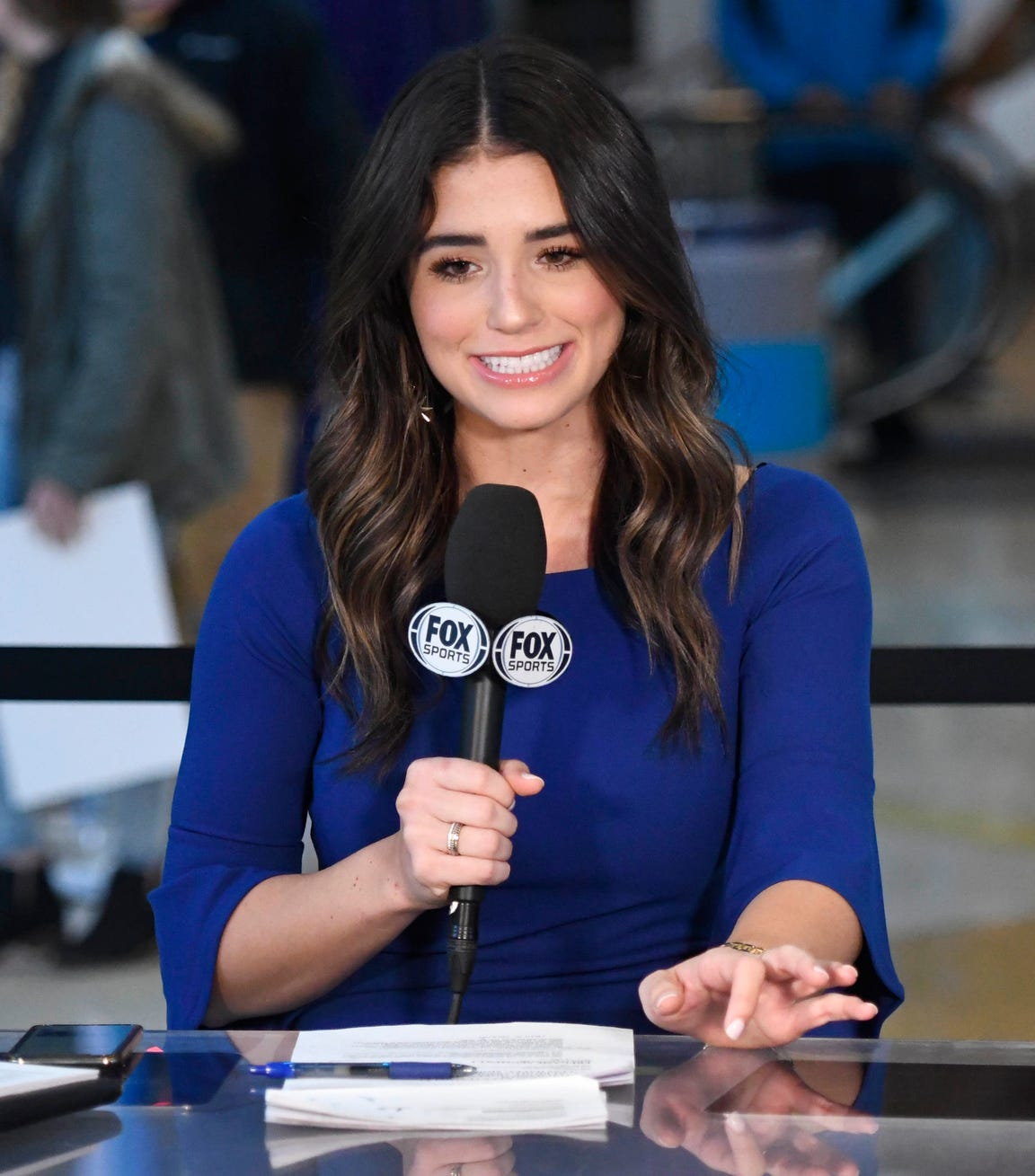 In this Wednesday, Dec. 19, 2018 photo, Ashley ShahAhmadi talks to the TV camera prior to the Charlotte Hornets game against the Cleveland Cavaliers at the Spectrum Center in Charlotte, N.C.