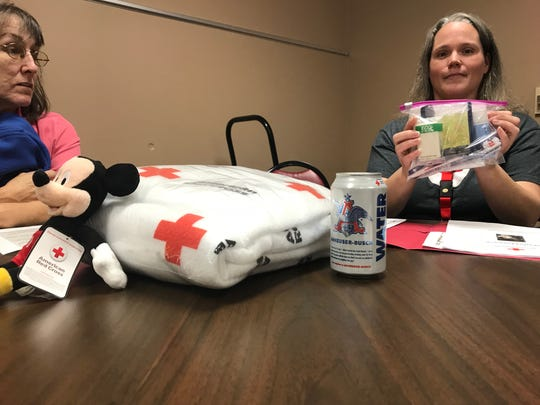 American Red Cross Volunteer Meghan Smith holds up an essentials pack that volunteers give to people who have recently lost their home to disaster at a recruitment event in Jackson on Saturday. Red Cross volunteers also deliver pre-loaded debit cards, blankets and stuffed animals.