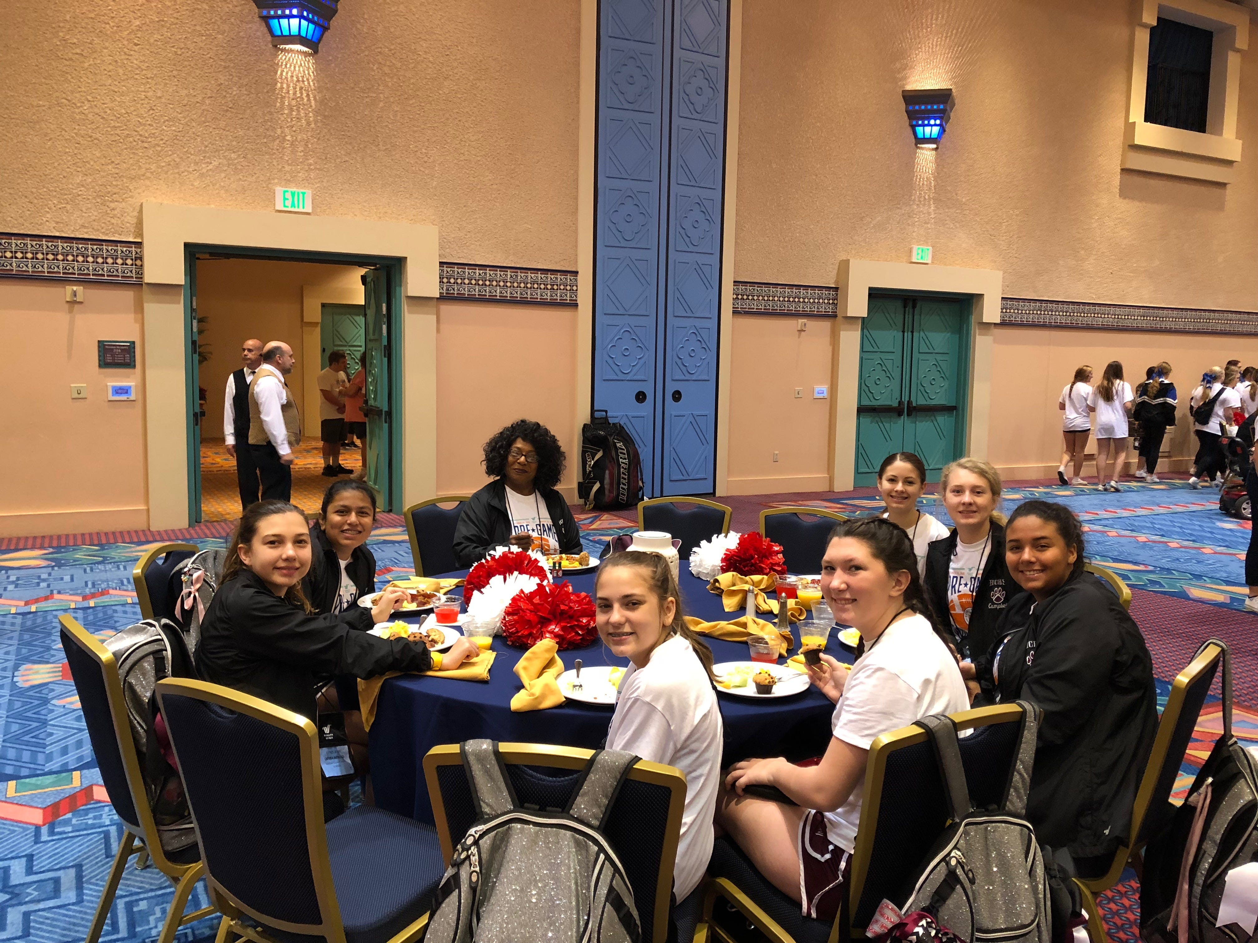 Coach Debra Hopson-Russell meets with some of the cheer team for breakfast before one of many practices for the Citrus Bowl pre-game show. Pictured, from left to right, are Jonvi Patel, Ciera Clark, Addison Hutcherson, captain Gracie Young, Sadi Turner, Campbell Register and Hannah Beth Riley.