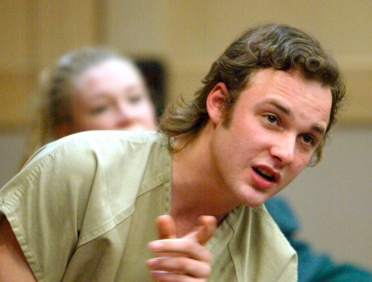 Jailed actor Brad Renfro, appearing in court Thursday, Feb. 7, 2002 before Broward Circuit Judge Ronald Rothschild for violation of probation charges, talks to his grandmother during a break in the proceedings.