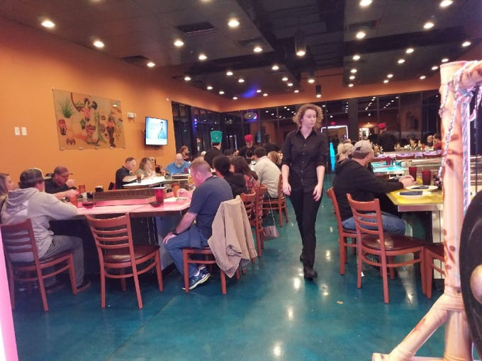 Asia Cafe offers a spacious dining area in their new location on Callahan Drive.