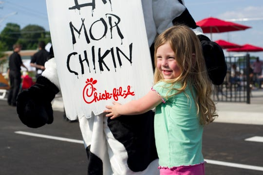 Elliana Seller, 4 hugs the Chick-fil-A cow mascot while posing for a photograph on Wednesday, May 16, 2012.