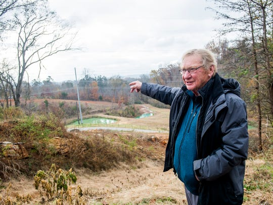 Tom Boyd points out features on his South Knoxville property on Wednesday, November 21, 2018. Boyd is planning on opening Ancient Lore Village at Boyd Hollow, a new 40-acre themed resort, on the property.