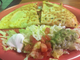 One menu option at Country Burrito Fresh Mex in Hardin Valley is the fajita quesadilla, here filled with chicken, grilled onions, bell peppers and tomatoes. This meal is served with lettuce, sour cream and guacamole.