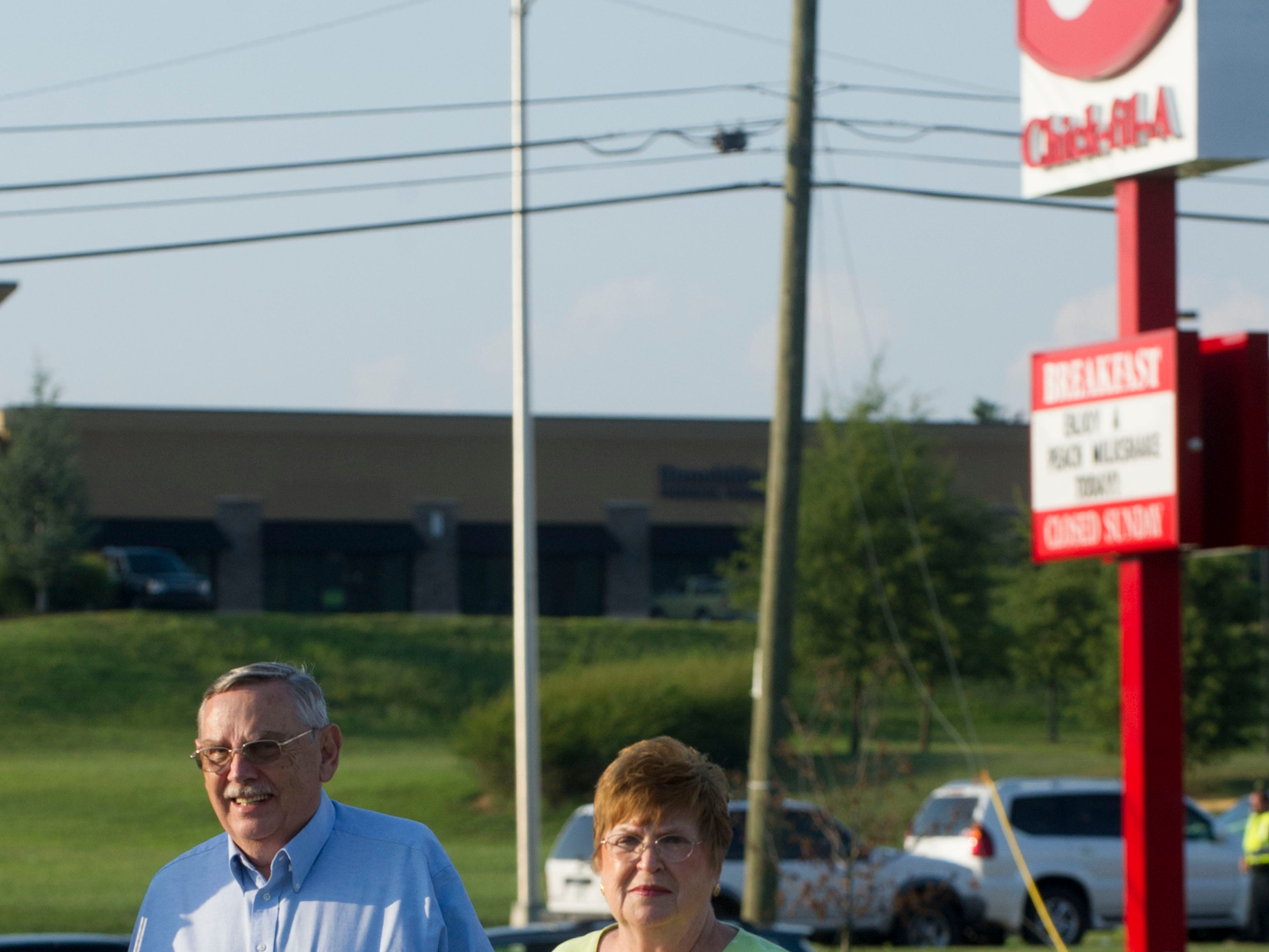 Gene Stafford and his wife Margie Stafford walk back to their cars after having their second meal of the day at Chick-fil-A on Emory Rd. The Staffords waited nearly an hour standing in line on Wednesday, August 1, 2012.