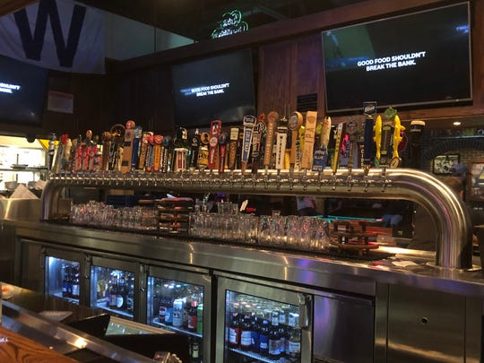 The bar at Carolina Ale House features a double row of 72 taps
