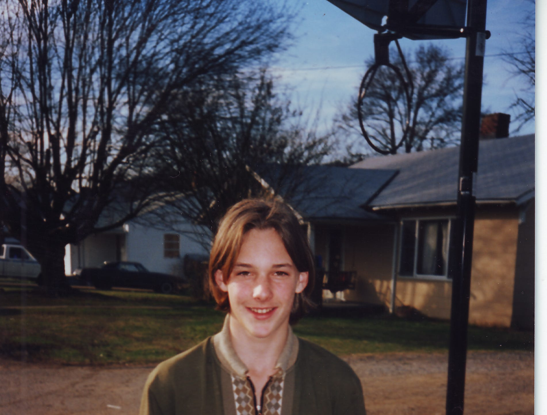 Even with one foot in Hollywood, Brad Renfro is still just a regular Knoxville kid in the front yard of his Lincoln Park home in an undated photo.