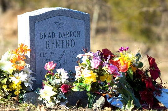 Flowers adorn the grave of actor Brad Renfro at Red House Cemetery in Blaine, Tennessee, on the one-year anniversary of his death.