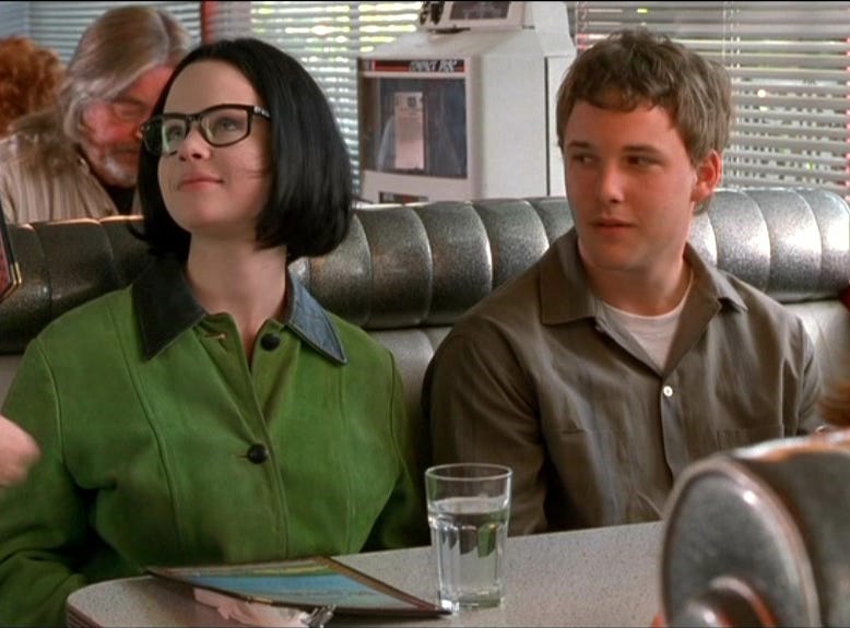 "Thora Birch, left, Brad Renfro and Scarlett Johansson (back to camera) in ""Ghost World."""