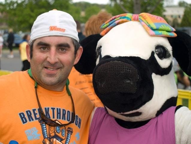 Seth Krichinsky and the Chick-Fil-A cow give out awards at the Breakthrough 5k Run/Walk and 1 Mile Fun Walk for Autism held in Turkey Creek. 2011