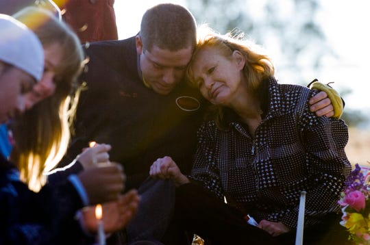Angel Olsen, right, mother of Brad Renfro, is comforted by Renfro's friend, Michael Franklin, on Jan. 15, 2009, at Red House Cemetery in Blaine, Tennessee.