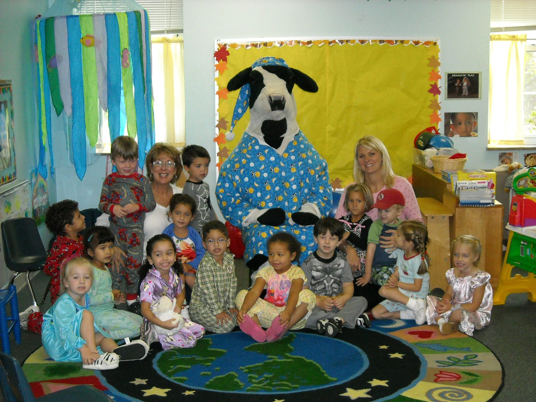 During a week-long breakfast promotion at Eddie Halliday's Chick-Fil-A, the breakfast cow decided to surprise the preschoolers at Central Baptist Church of Bearden on pajama day. Pictured in no particular order are teachers Robin Triplett and Jamie Holden with students Natalie Olden, Emily Adams, Zach Sanborn, Griffin Cox, Melaine Pascoe, Willow Martinez, Walker Martinez, Cole Etheridge, Sydney Mwangi, Henry Bertucci, Olivia Kennedy, Jack Steed, Isa Young and McClain Riggins.