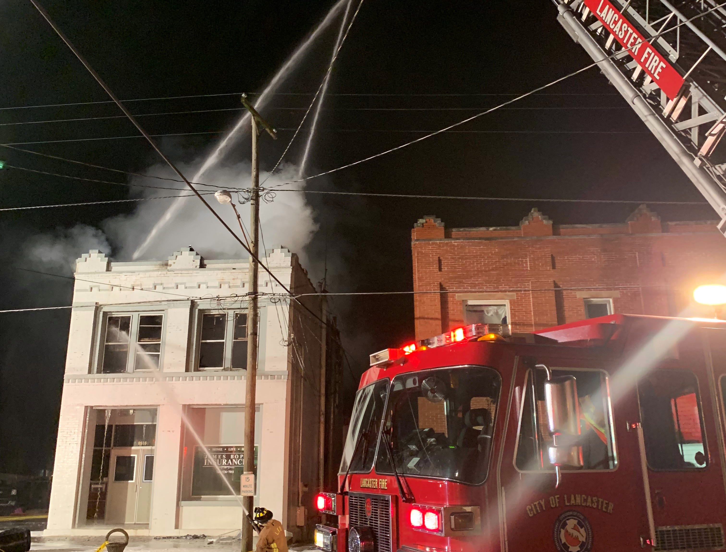 Firefighters battle a rekindled fire early Friday morning, Jan. 4, 2019, on Main Street in Rushville.