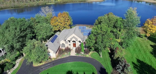 About 28 solar panels cover a 6,800-square foot luxury home on Worden Lake near Brighton.