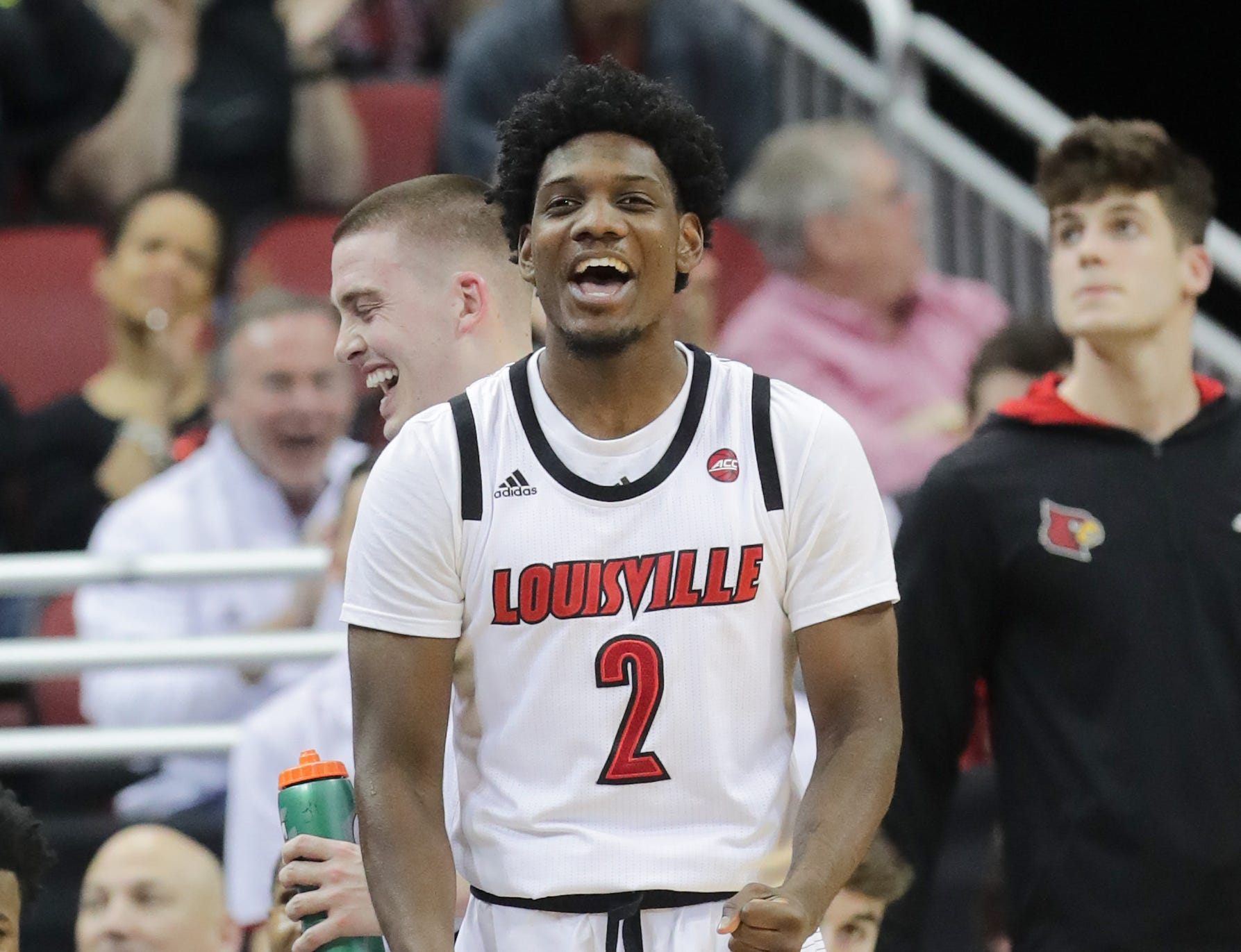 Louisville's Darius Perry celebrates from the bench. 