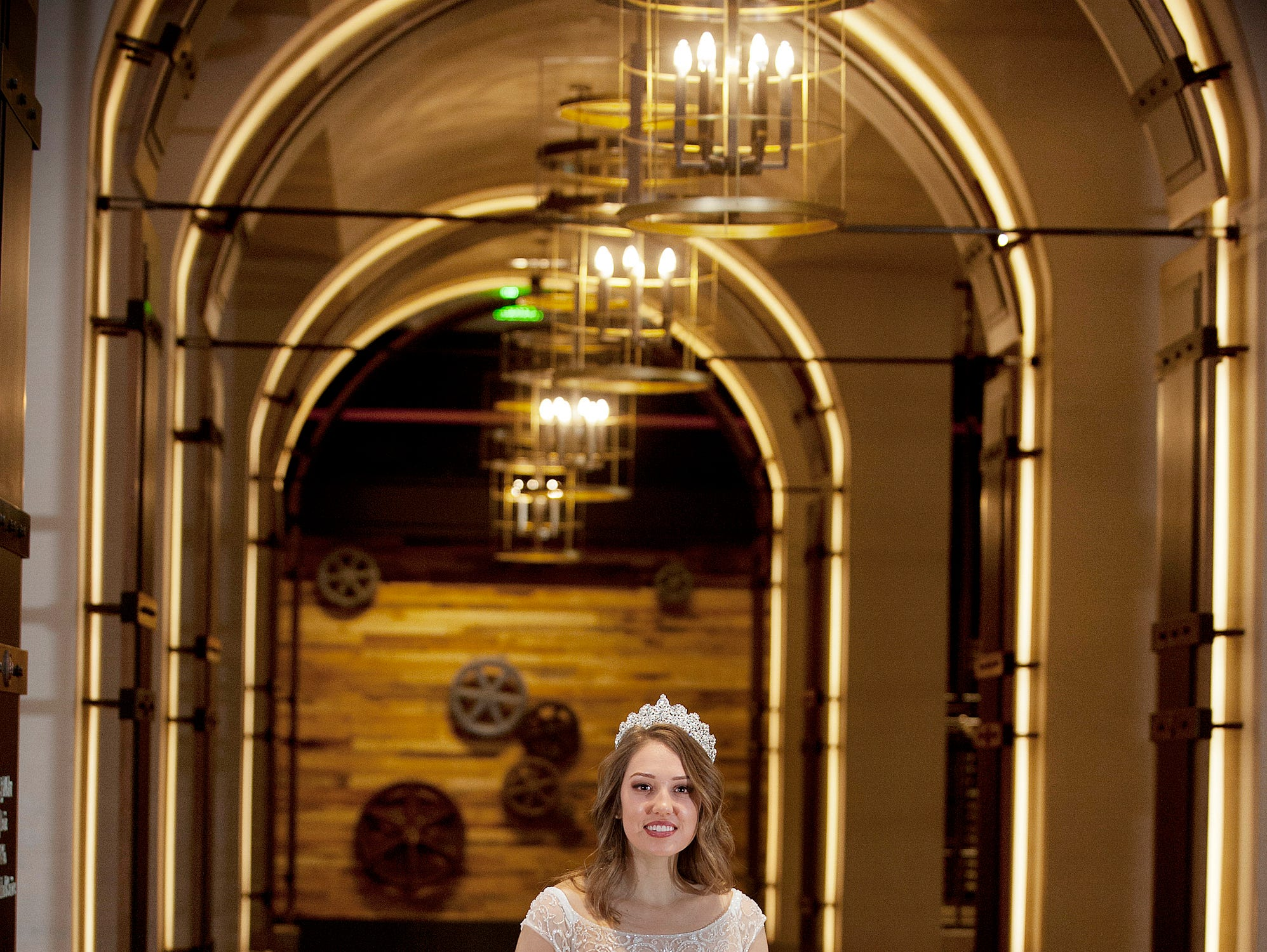 Kentucky Derby Festival Princess Elizabeth Seewer, 23, of the Springhurst neighborhood in Louisville, is in Bellarmine University's graduate physical therapy doctoral program. She posed for her photo in an archway of the Omni Louisville Hotel lobby. 06 January 2019