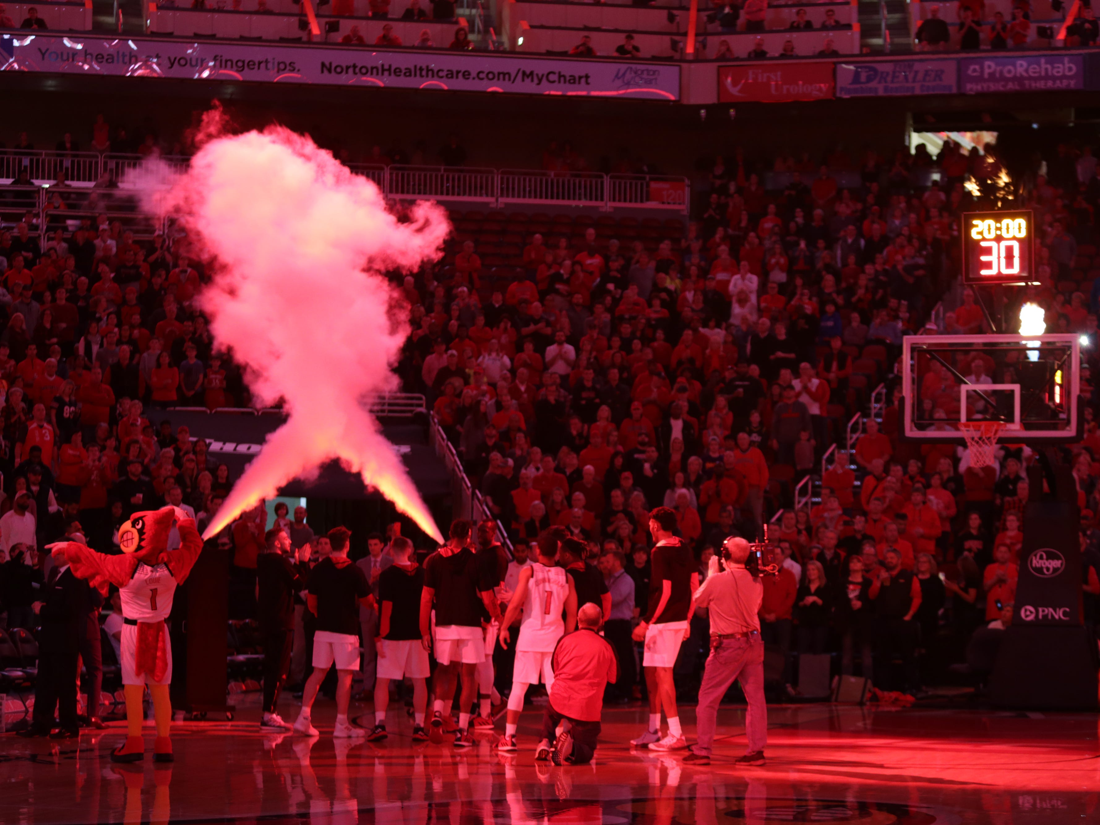 The University of Louisville's men basketball team is introduced before their game against Miami. Jan. 6, 2018.