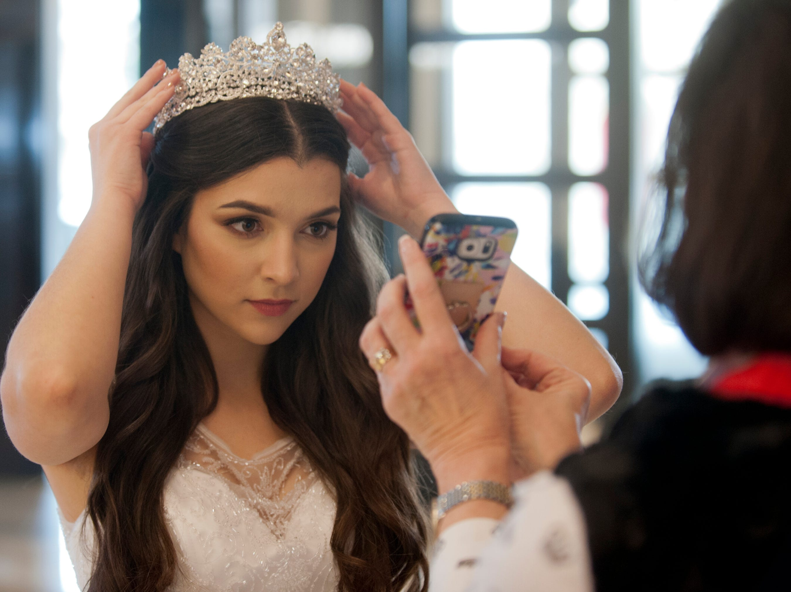Kentucky Derby Festival Princess Mary Baker, 20, of Old Louisville, is a University of Louisville junior majoring in economics and finance.She was using the camera in a smart phone as a mirror to adjust her tiara. 06 January 2019