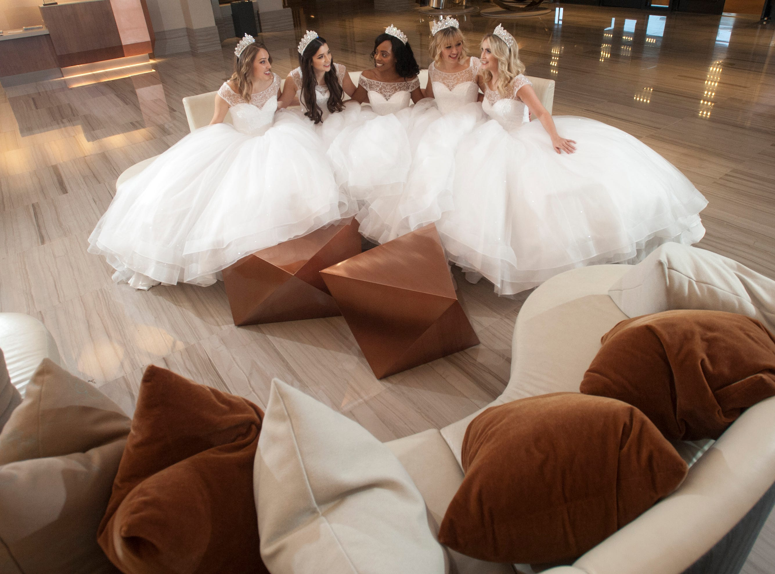 Kentucky Derby Festival Princesses (l-r) Elizabeth Seewer, 23, Mary Baker, Brittany Patillo, Kelsey Sutton and Allison Spears relax on a couch in the lobby of the Omin Louisville Hotel. January 2019
