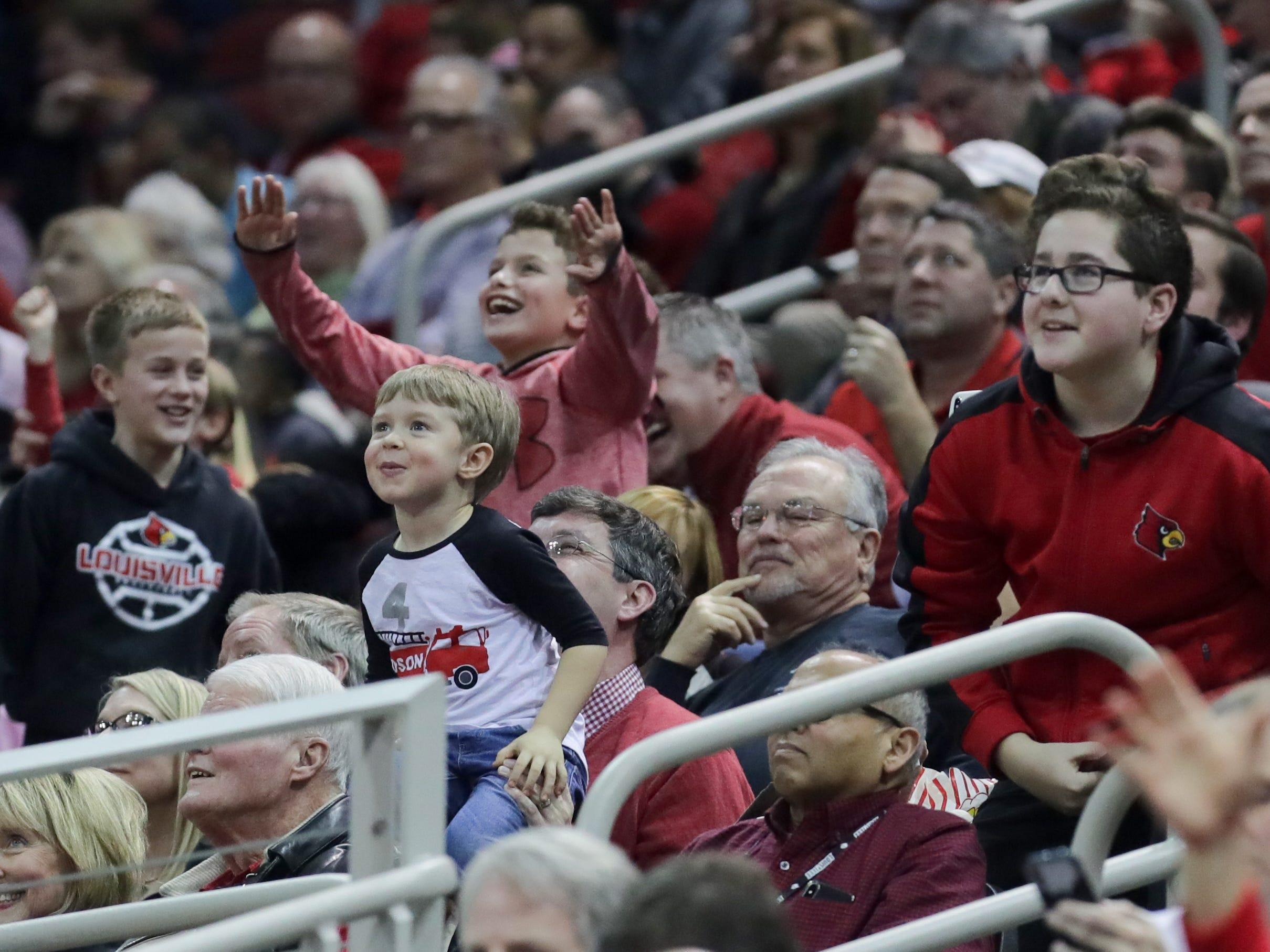 Louisville fans cheer on the Cardinals. Jan. 6, 2018