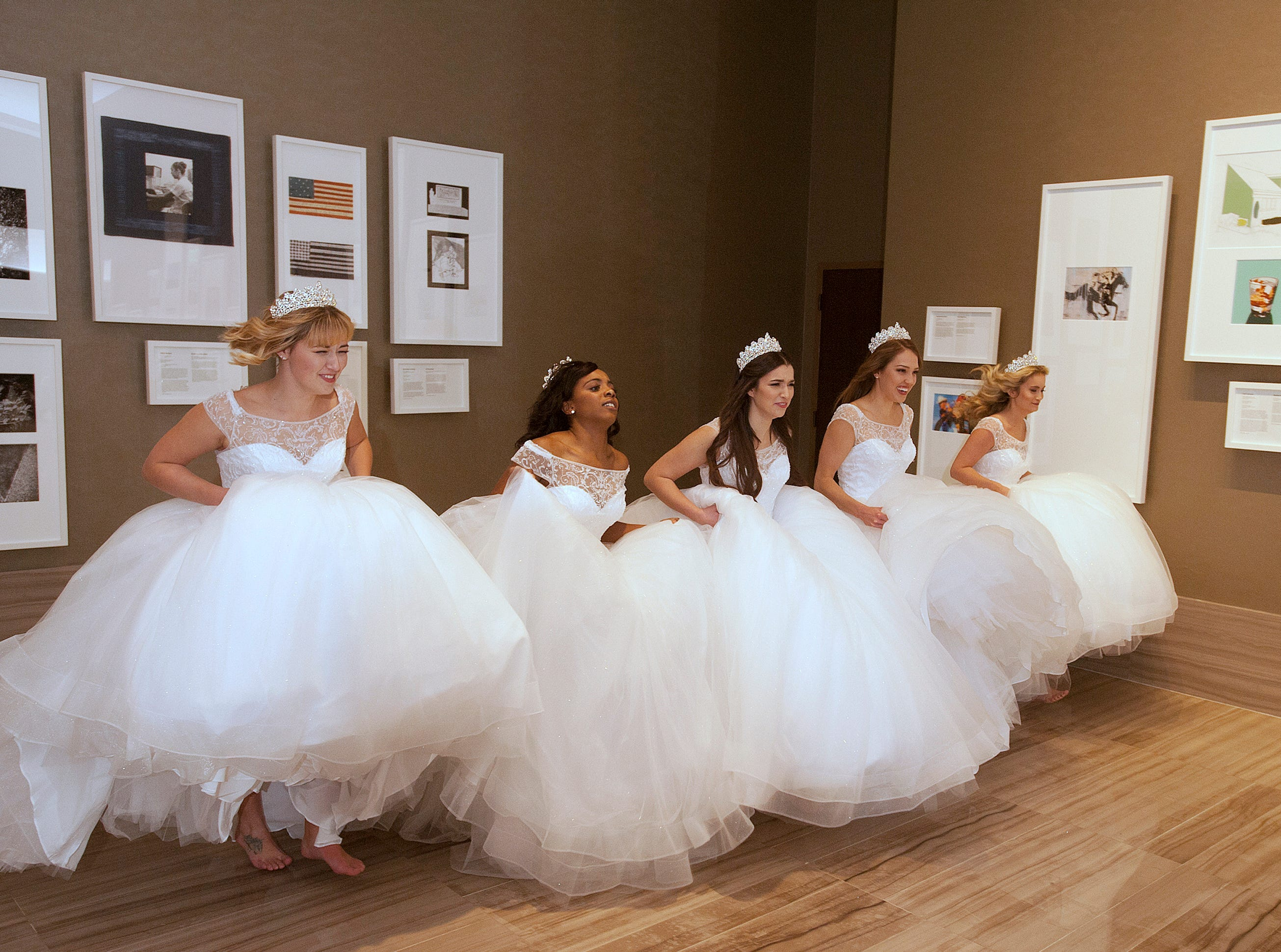 Kentucky Derby Festival princesses run together through the Omni Louisville Hotel. L-R: Kelsey Sutton, Brittany Patillo, Mary Baker, Elizabeth Seewer and Allison Spears. 06 January 2019