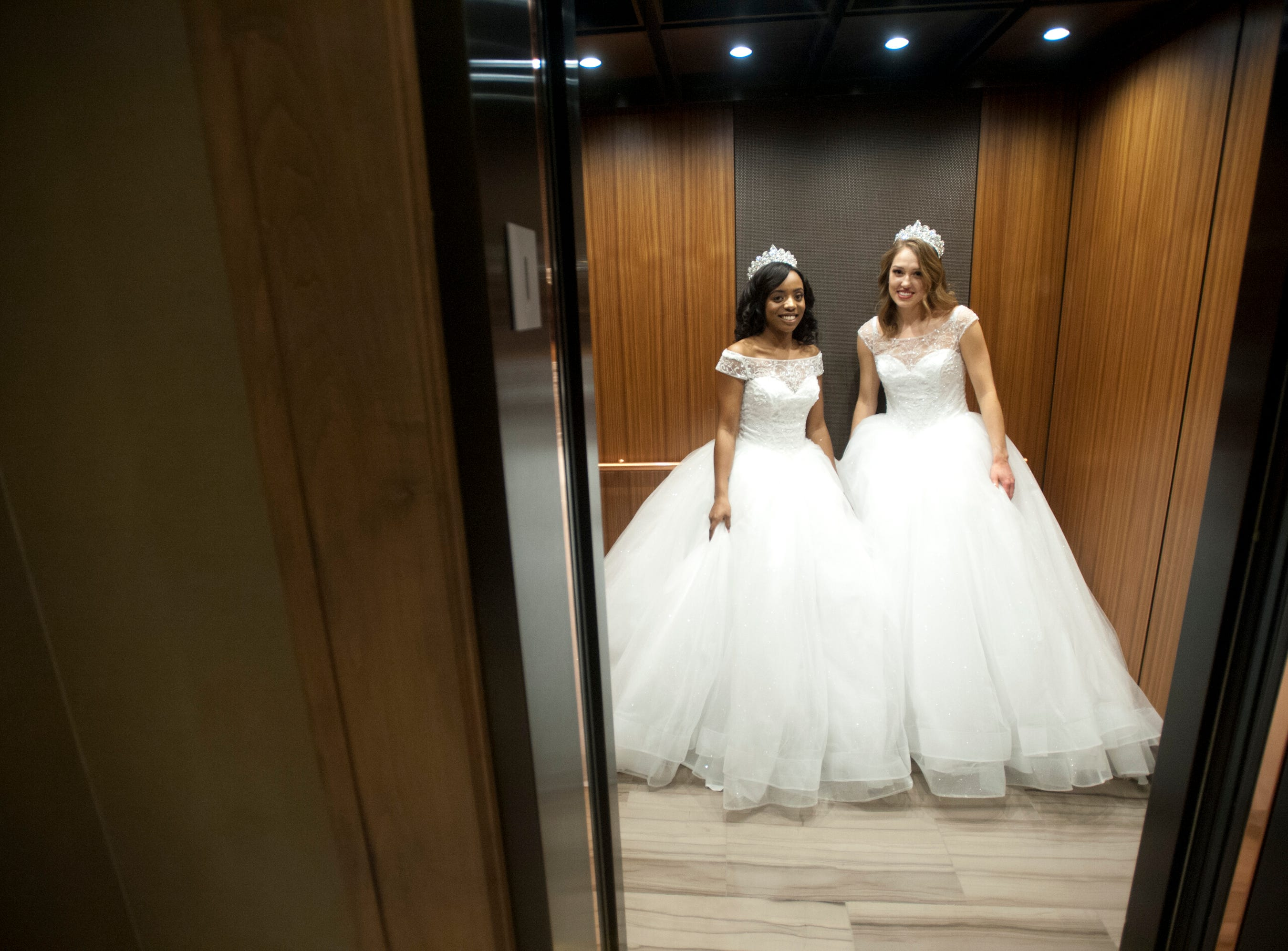 Going up in the elevator of the Omni Louisville Hotel are Kentucky Derby Festival Princesses Brittany Patillo, left, and Elizabeth Seewer, right.  Patillo, 22, from the west end of Louisville, is a University of Louisville senior majoring in theater arts and Seewer, 23, of the Springhurst neighborhood in Louisville, is in Bellarmine University's graduate physical therapy doctoral program. 06 January 2019