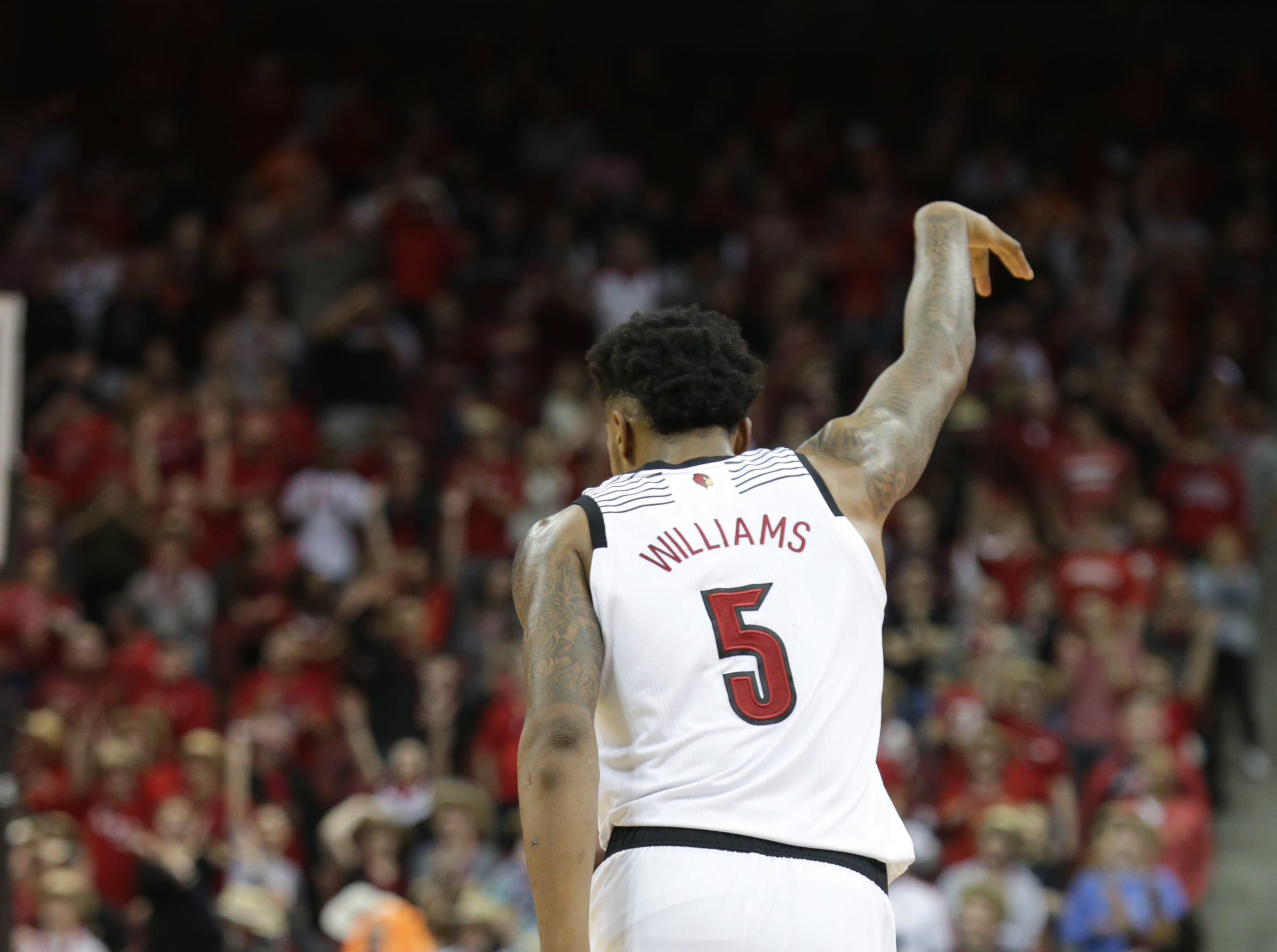 Louisville's Malik Williams celebrates after hitting a three point shot during the second half against Miami. Williams scored19 points in the game. Jan. 6, 2019.