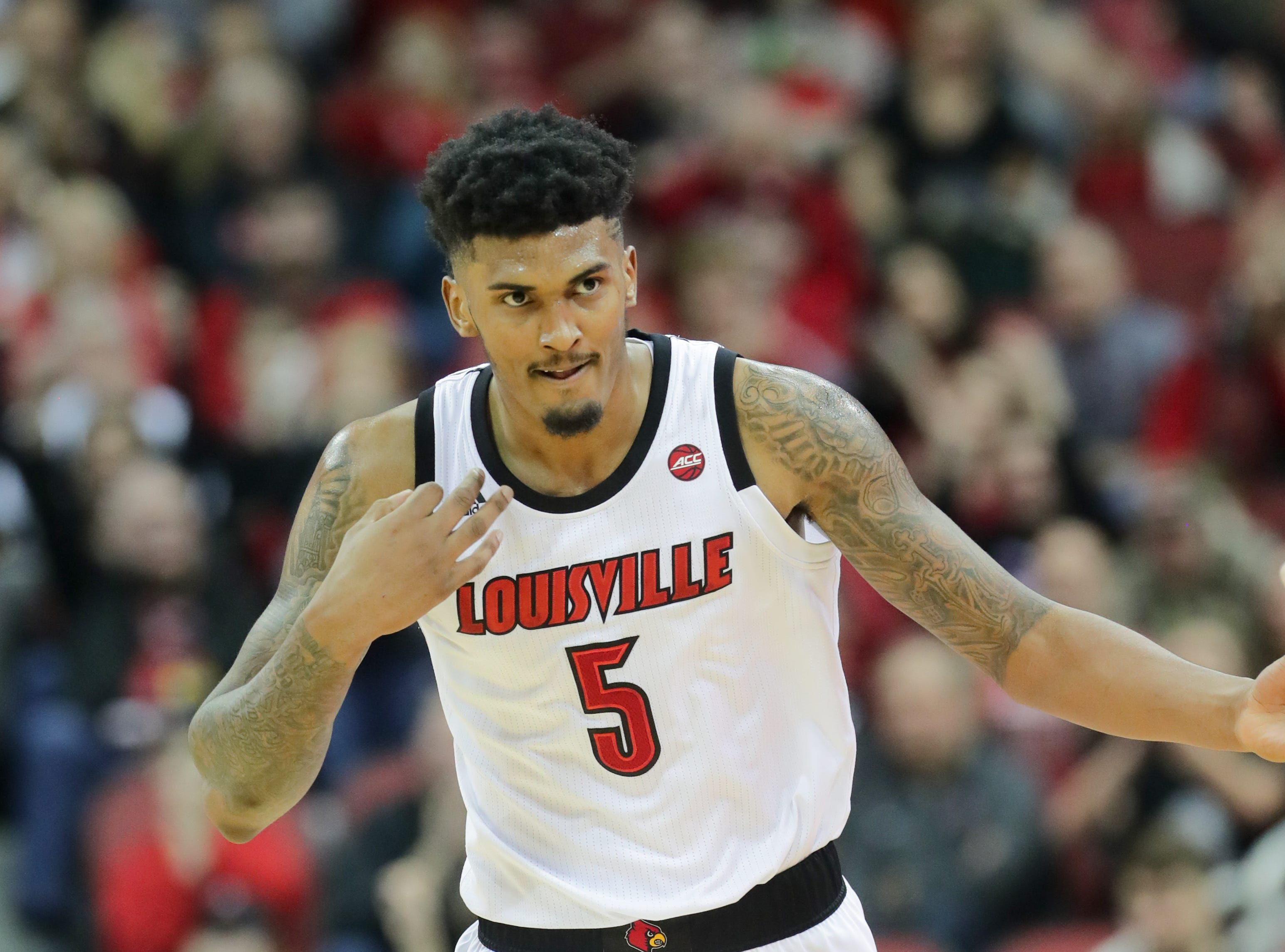 Louisville's Malik Williams plays his own string music after knocking down a three. 