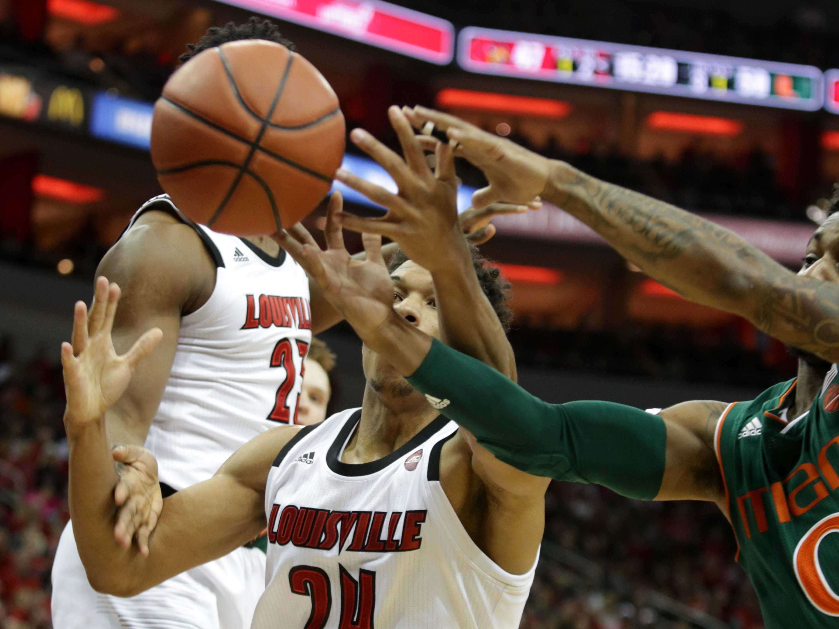 Louisville's Dwayne Sutton battles for a loose ball during second half action against Miami. Jan. 6, 2019.