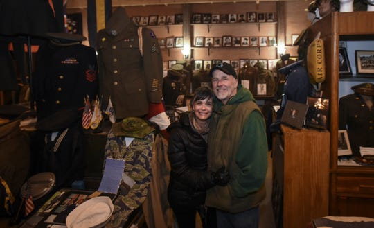 Scott Shattuck and his wife Debbie Dancer-Shattuck of Mason.  Five generations of Scott Shattuck's family have lived in his 131-year-old farmhouse. The property houses Shattuck's extensive collection of war memorabilia.
