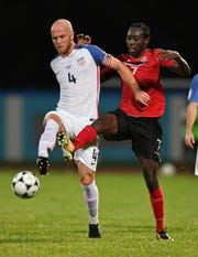 USA's Michael Bradley (L) and Trinidad and Tobago's Nathan Lewis vie for the ball during their 2018 World Cup qualifier football match in Couva, Trinidad and Tobago, on October 10, 2017.