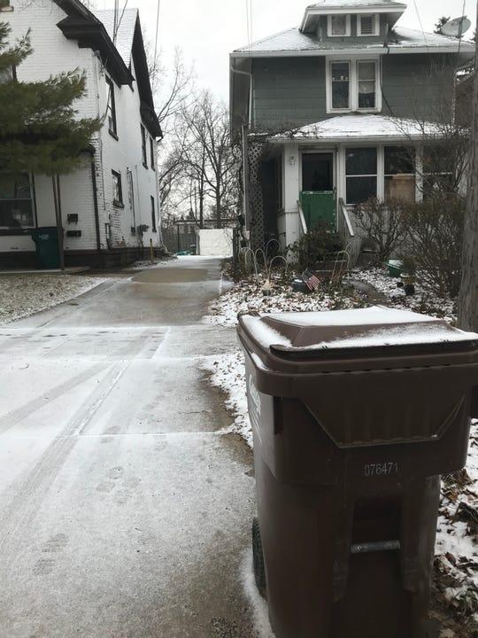 Lansing State Journal file photo: A garbage cart awaits pickup in front of Charles Haynes' home in Lansing's Green Oaks neighborhood.