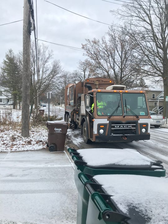 A Granger garbage truck prepares to empty a barbage container in front of Charles Haynes' house Jan. 3, 2019. Haynes has been warned not to store his cans at the curb.