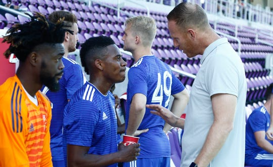 Dejuan Jones (middle) gets instruction from his coach Mike Behomick (right) during the Adidas MLS Soccer Combine at Orlando City SC Stadium.