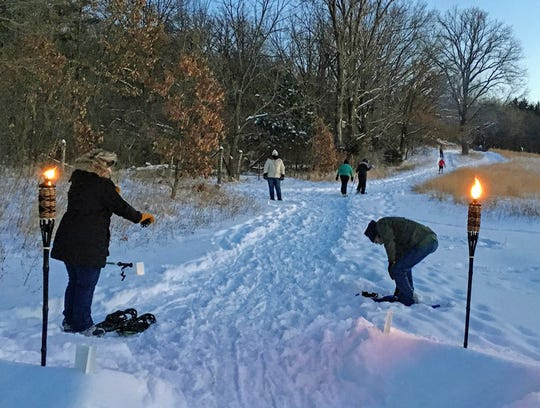 """More than 35 candlelight events are scheduled this winter at Wisconsin State Park System properties. While the events are labeled """"candlelight,"""" some properties use Tiki torches or other luminaries."""