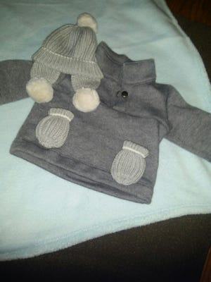 Baby Timothy, just weeks old, will wear warm hat, coat and mittens for his buggy rides to Grandma and Grandpa Eicher's.