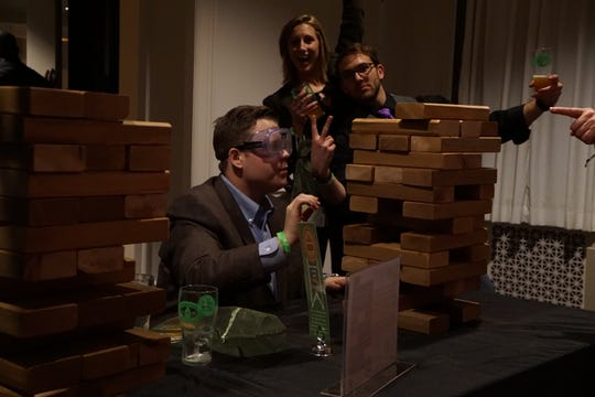 "Guests at the Pink Palace Museum's ""Science of Beer"" event can play games like giant Jenga while wearing beer googles."