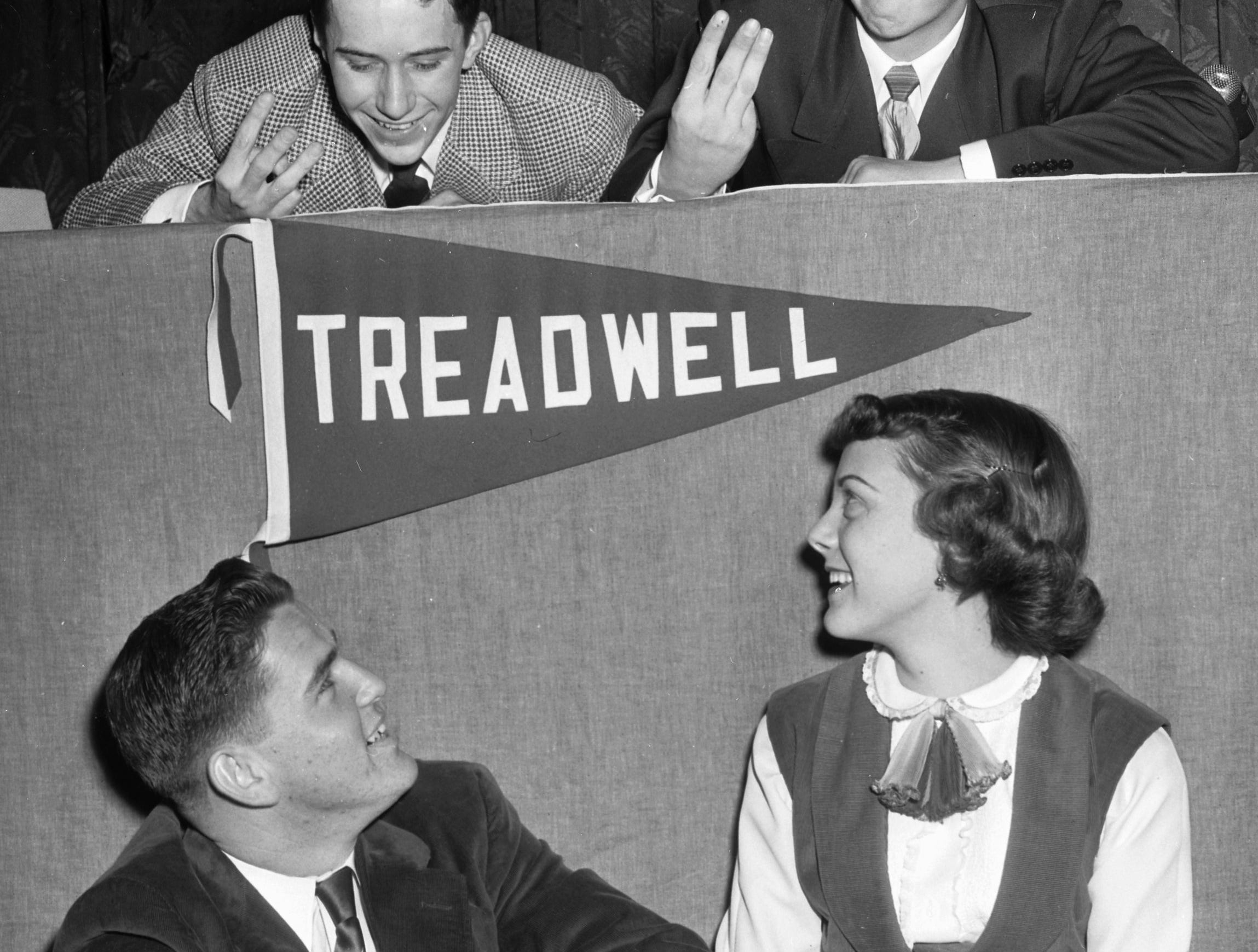 Treadwell High School made it three in a row on the Quiz 'Em on the Air Contest on 10 Feb 1951 as Tommy Graham (Top Left) and Joe Spann (Top Right), members of the team, indicate with upraised fingers.  Also on the team are Billy Caldbeck (Lower Left) and Mary Anne Sellers.