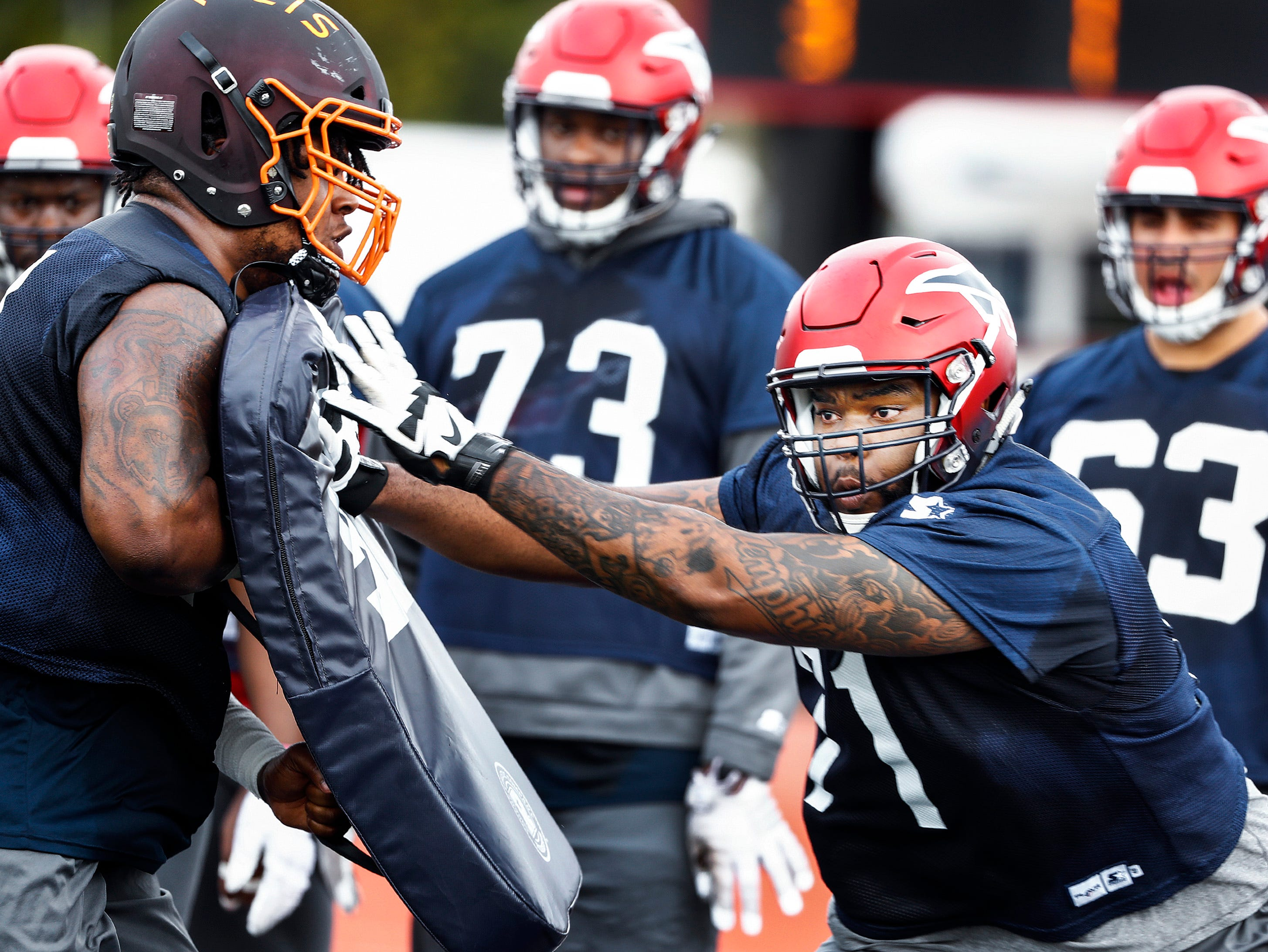 Memphis Express offensive lineman Christian Morris (right) during training camp in San Antonio, Texas.