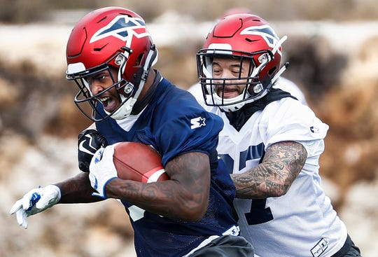 Memphis Express receiver Kayaune Ross (left) makes a catch against defender Brandon Neal (right) during training camp in San Antonio, Texas.