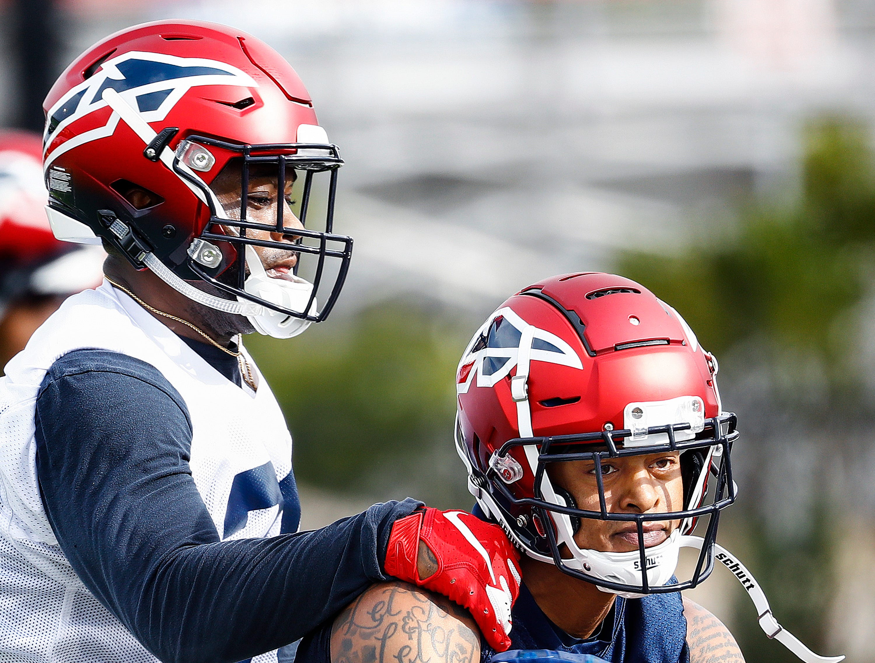 Memphis Express receiver Chris Givers (right) makes a catch in front of defender Tyree Robinson (left) during training camp in San Antonio, Texas.