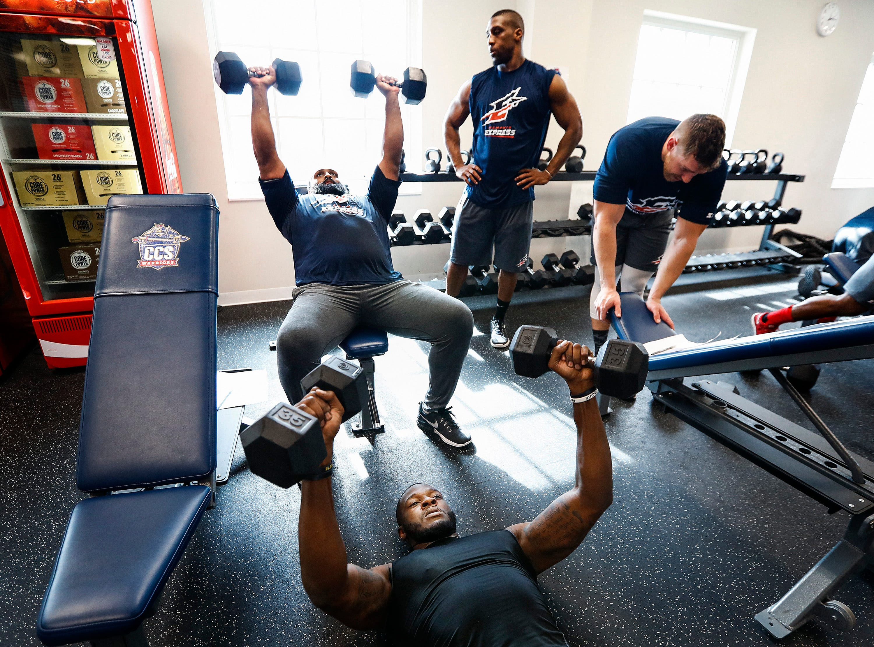 Memphis Express defensive team members lift weights during training camp in San Antonio, Texas.