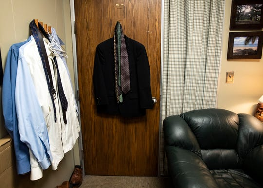 In addition to the office clothes closet, attorney Gregg Carman keeps clothes in his own office to lend to defendants when they go on trial.