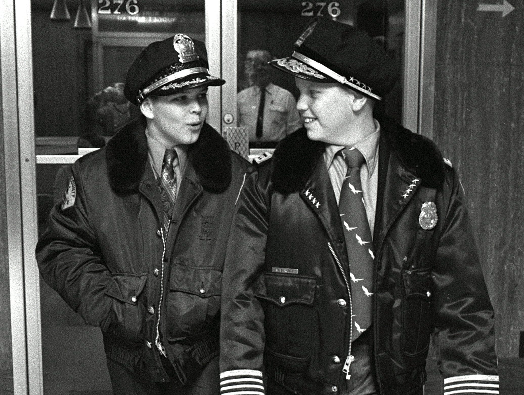 Tom Graves (Left) of 3192 Court and Jimmy Grace (Right), of 4752 Linda Lane, both 11, were named Junior Sheriff and Junior Police Chief in a ceremony at Police Headquarters on 5 Feb 1971.  They were selected from thousands of boys who competed in the Exchange Club's annual competition.  They will receive their badges and certificates at a Crime Prevention Week ceremony at the Sheraton-Peabody Hotel.