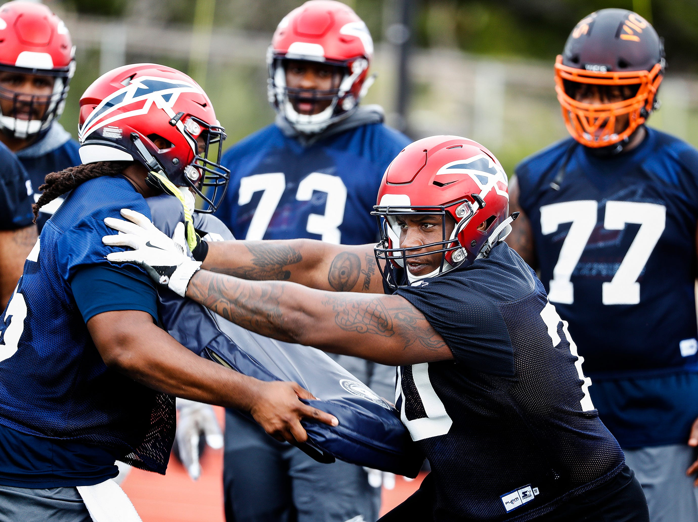 Memphis Express offensive lineman Robert Myers (right)  during training camp in San Antonio, Texas.