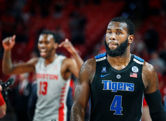 Memphis forward Raynere Thornton (right) walks-off the court as Houston celebrates a 90-70 victory.