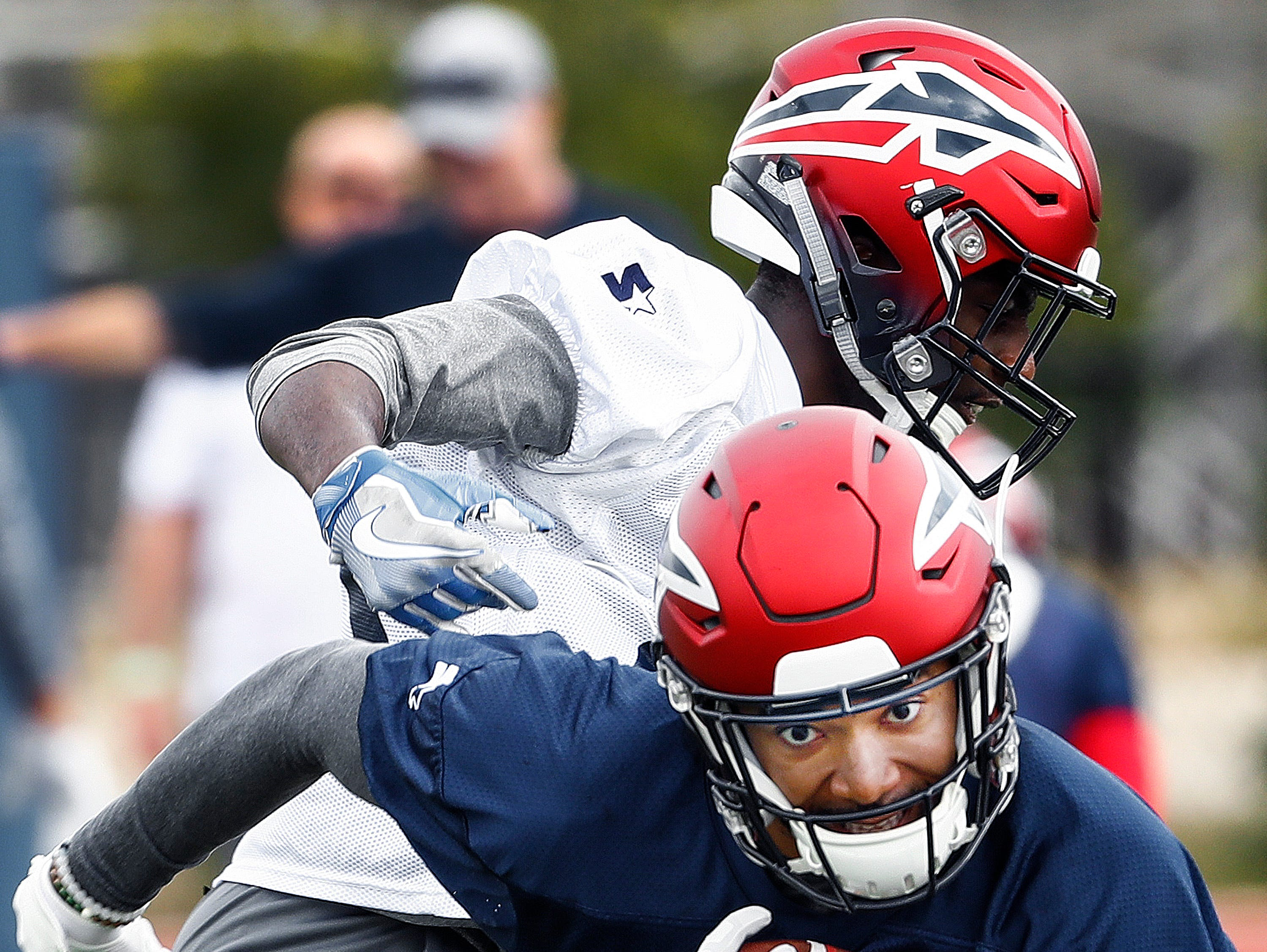 Memphis Express receiver Gerrard Sheppard (front) makes a catch in front of defender Jahmahl Pardner (back) during training camp in San Antonio, Texas.